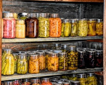 lots of homemade canned vegetables in jars